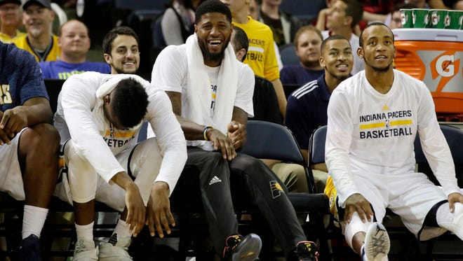 Indiana Pacers forward Paul George (center) shares a laugh from the bench with teammates during a game against the Milwaukee Bucks at Ford Center.
