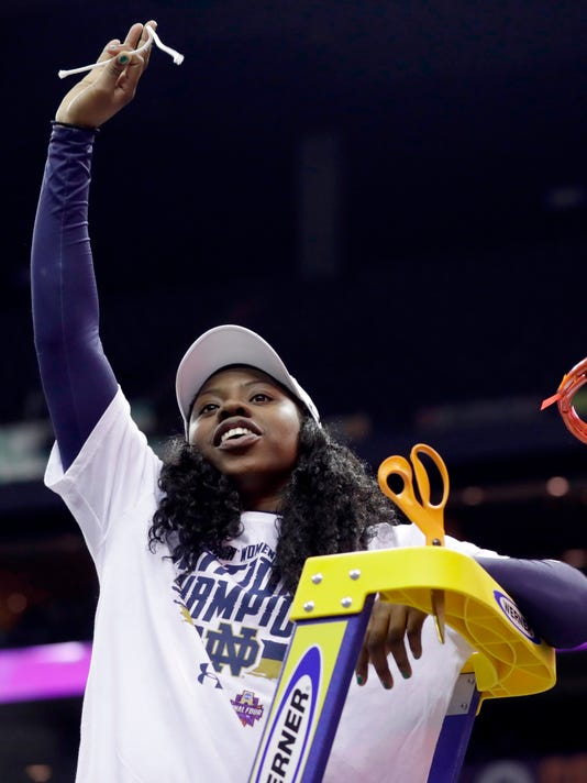 Notre Dame's Arike Ogunbowale celebrates by cutting down the net after a 61-58 victory over Mississippi State in the final of the women's NCAA Final Four college basketball tournament, Sunday, April 1, 2018, in Columbus, Ohio. Notre Dame won 61-58. (AP Photo/Tony Dejak)