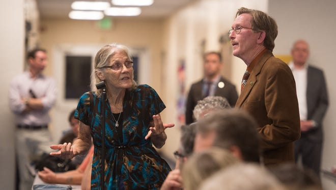 Lakewood Park resident Leslie Hughes voices her frustration to St. Lucie County Director of Public Works Don West during a meeting, organized by County Commissioner Cathy Townsend, at Lakewood Park Elementary School on Tuesday, Oct. 10, 2017, to address flooding and drainage issues following Hurricane Irma.
