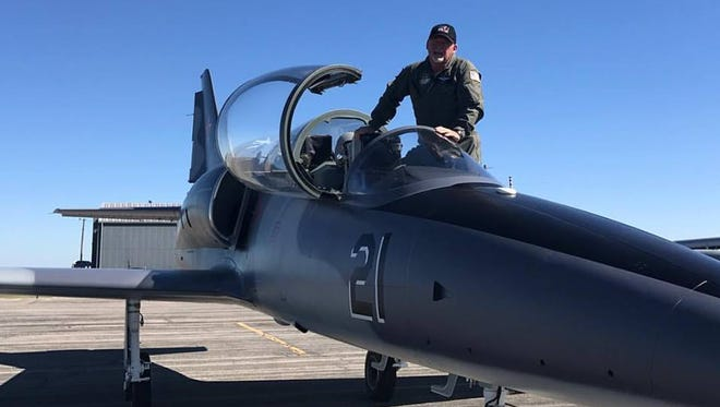 Dr. Jay Baxley, a Vernon dentist, poses with his jet aircraft.