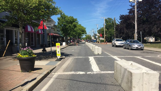 Concrete barriers in place along Hyannis Main Street reserve one lane for vehicular traffic, opening up more space for outdoor dining and sidewalk sales.