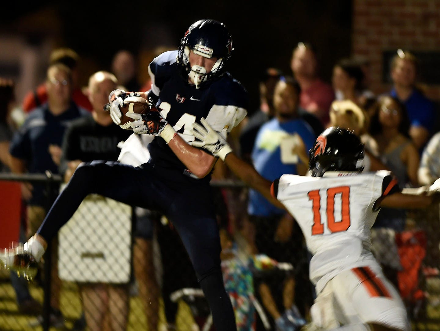 WH Heritage' s Nick Desmarais (14) pulls down a touchdown pass over Stratford's Rod Reed (10) in the first half during week 5 of High School Football on Friday, September 16.