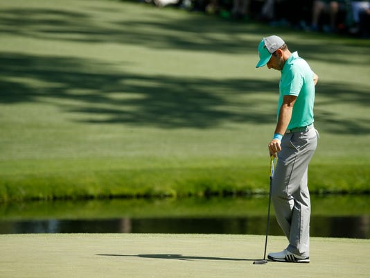 Sergio Garcia, of Spain, pauses on the 15th green during the first round at the Masters golf tournament Thursday, April 5, 2018, in Augusta, Ga. Garcia shot an 8-over 13 on the hole. (AP Photo/Charlie Riedel)