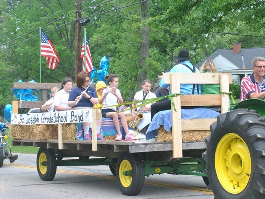St. Joseph School's band plays aboard a float in the Crestview Memorial Day Parade.