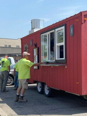 Here, some construction workers load up on Drafts' famous mac and cheese, and sandwiches.