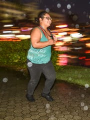 Pacific Daily News' 2017 Bridal Boot Camp recruit Holi Tainatongo makes her way back to the starting point during a workout run through Tumon on Wednesday, Jan. 18, 2017.