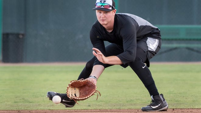 Pavin Smith takes a hit ball down during Visalia Rawhide practice at Recreation Park on Tuesday, April 3, 2018. Their season opener is Thursday.