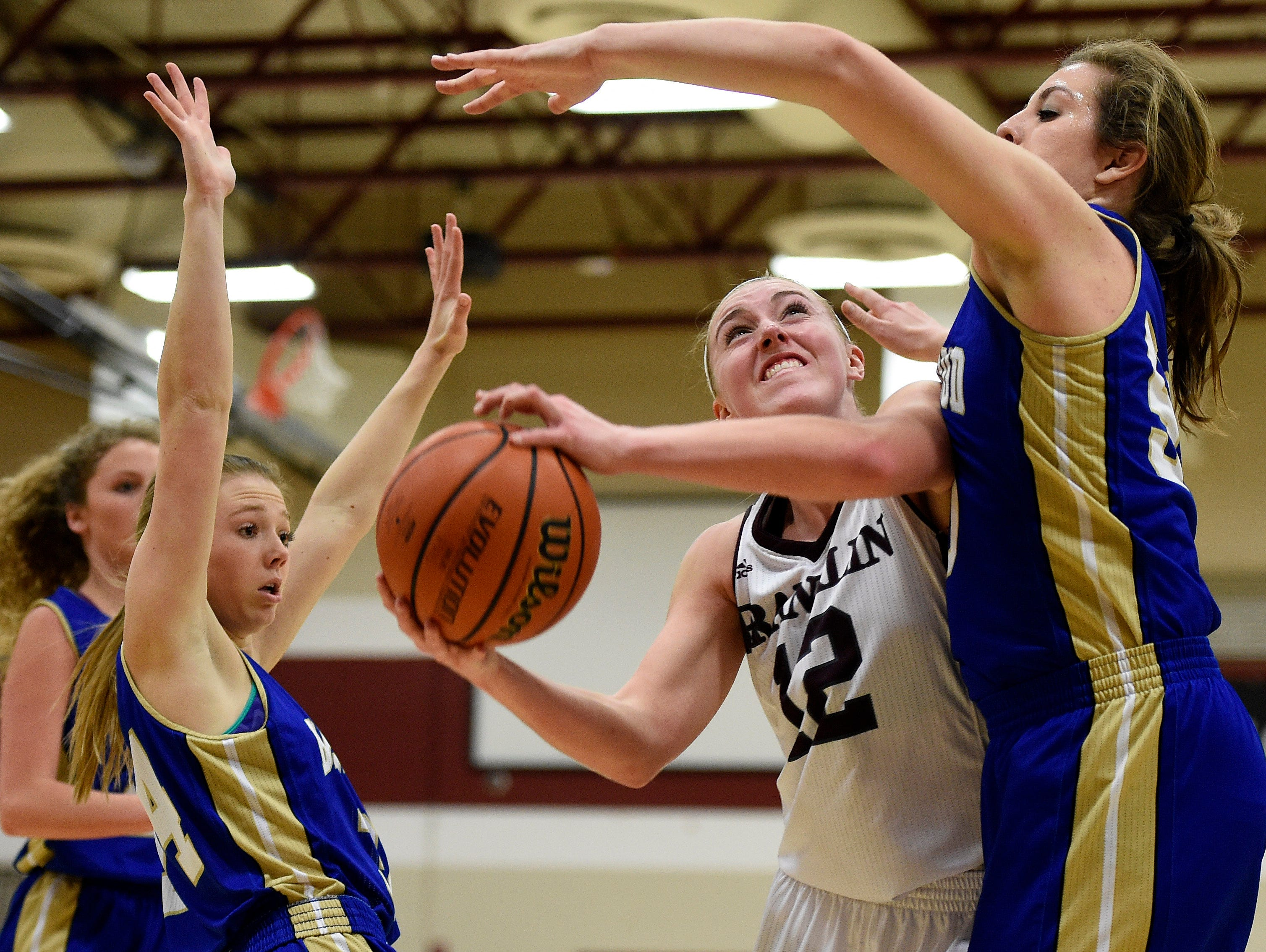 Franklin's Holly Harris (12) shoots past Brentwood's Taylor Sexton (50) during the first half at Franklin High School, Tuesday, Feb. 16, 2016, in Franklin, Tenn.