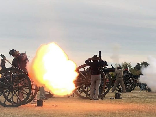 Re-enactors fire their cannons Saturday, Dec. 2, 2017, at Fort Concho National Historic Landmark during the annual Christmas at Old Fort Concho.