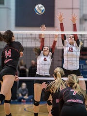 Churchill's Annie Yost (12) and Brianna Fulton (middle) go up for the block against Romeo's Gia Milana.