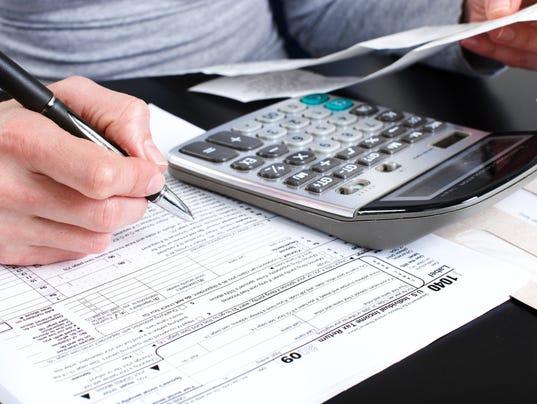 ELM tax-forms-ThinkstockPhotos-146793326.jpg
