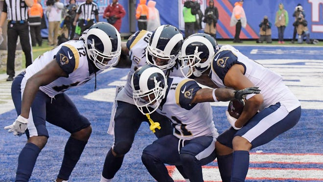 Los Angeles Rams' Tavon Austin (11) celebrates with teammates Sammy Watkins (12), Todd Gurley (30) and Robert Woods (17) after Woods caught a pass for a touchdown during the second half of an NFL football game against the New York Giants, Sunday, Nov. 5, 2017, in East Rutherford, N.J. (AP Photo/Bill Kostroun)