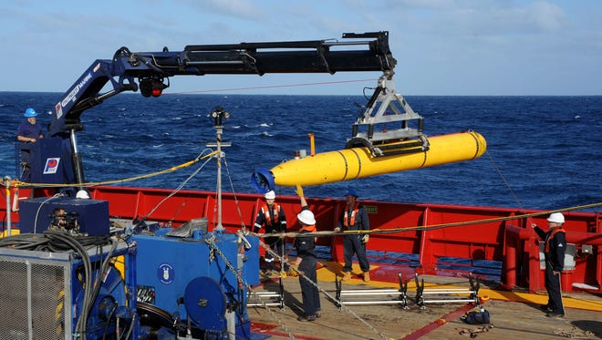 The U.S. Navy's  Bluefin 21 autonomous sub is hoisted back on board an Australian military vessel on April 21 during the search for the missing Malaysia Airlines Flight 370.