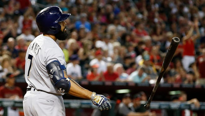 Eric Thames of the Brewers tosses his bat after striking out in the fifth inning Sunday in a loss to the Diamondbacks in Phoenix.