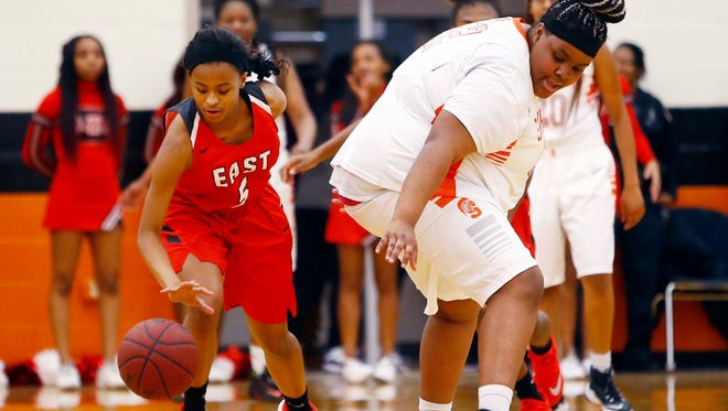 East Nashville's Tameia Shaw (5) steals the ball from Stratford's Mya Swanson during their game Jan. 5.