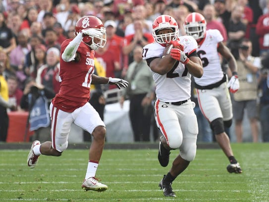 Georgia Bulldogs running back Nick Chubb churns out