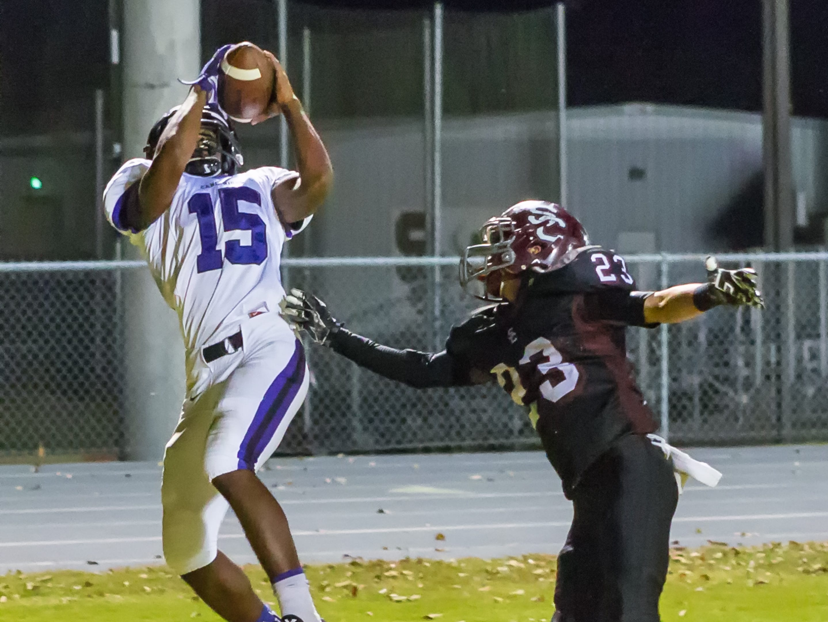Cane Ridge's Jared Mccray, 15, catches a pass over Station Camp's, 23, Austin Hawkins on Friday, October 23, 2015.