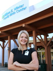 Sarah Fronza, interim CEO of Silverton Health, is photographed on Thursday, Aug. 6, 2015, in front of the Family Birth Center at Silverton Hospital.