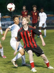 Rossview's Grant Keel looks to head the ball against
