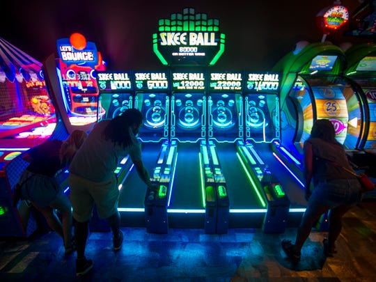 Main Event Entertainment boasts more than 100 arcade games, food and a full bar.