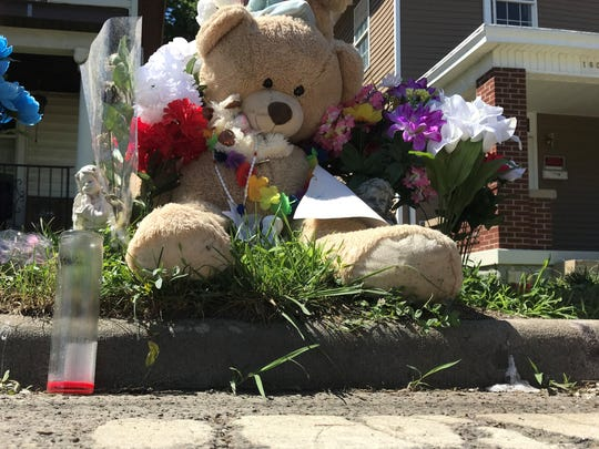 A memorial of teddy bears and flowers near the intersection