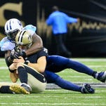 Tennessee Titans outside linebacker Brian Orakpo (98) sacks New Orleans Saints quarterback Drew Brees (9) during the second half of Sunday's game at the Mercedes-Benz Superdome.