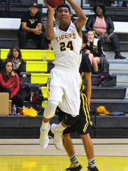 Alamogordo's Chamar Norman puts up a shot Friday night.