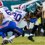 Eagles running back DeMarco Murray is tackled by Bills corner Corey Graham in the fourth quarter last Sunday.