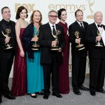 'Downton Abbey' cast members, writers and producers pose with their first Emmys for outstanding writing and outstanding miniseries or movie at the 63rd Primetime Emmy Awards. The producers of show announced on Thursday that the upcoming sixth season of the drama series will be its last.