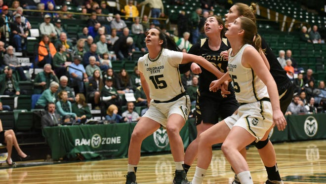 CSU's Veronika Mirkovic (15) and Lore Devos (35) box out a pair of Idaho players while positioning themselves for a rebound during Friday night's game at Moby Arena.