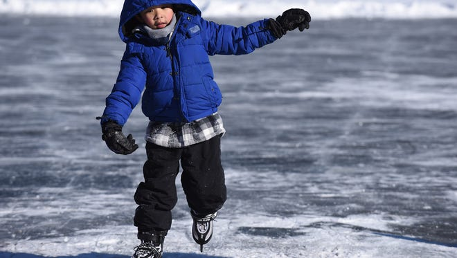 Ice skating at Cooper's Pond in Bergenfield on Saturday January 06, 2017. Coco Tipwan - 6 from Bergenfield skates on the frozen pond.