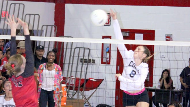Hannah Burnett of the Lady Indians tallies this kill late to help Cobre come back to defeat Morenci in the first set of Thursday night's action.