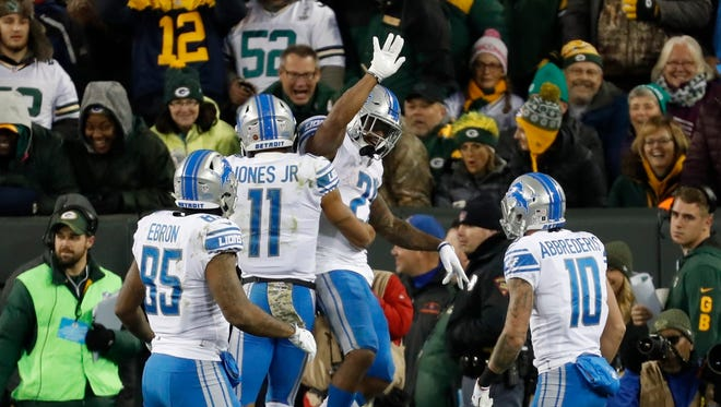 Lions RB Ameer Abdullah (center right) celebrates his touchdown with Marvin Jones (11) in the first half against the  Packers, Nov. 6, 2017 in Green Bay.