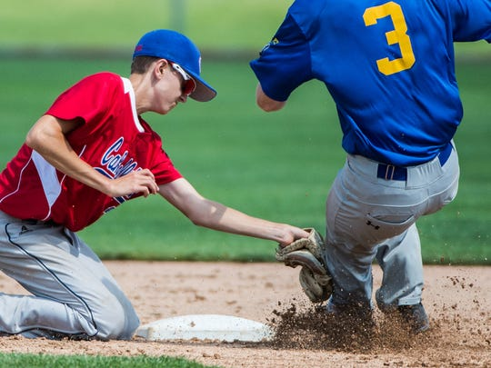 Campbelltown's Chris Good tags out Linglestown's Luke McNamara as he tries to steal second base as Campbelltown defeated Linglestown 2-1 in Fredericksburg on Saturday in a Region Four opener.