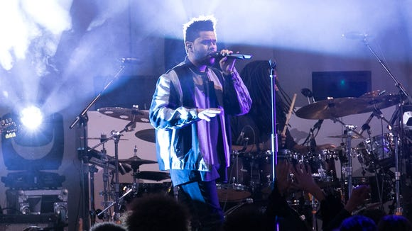 The Weeknd singing at the H&M fashion show.