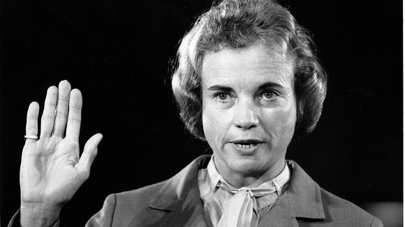 Supreme Court nominee Sandra Day O'Connor raises her right hand to be sworn in before the Senate Judiciary Committee on Capitol Hill on Sept. 9, 1981.