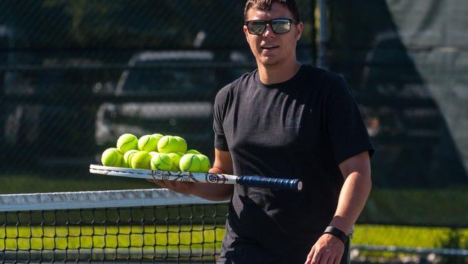 Ryan Marshall makes himself useful on the tennis courts.