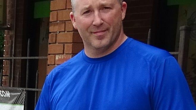 John Nolan, owner of Four Seasons Graphics on Greenwood Avenue