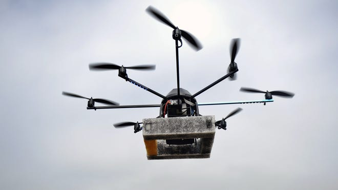 A man controls a drone in Lima on July 10, 2013.