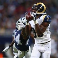 Brian Quick #83 of the St. Louis Rams catches a touchdown pass against Morris Claiborne #24 of the Dallas Cowboys in the second quarter at the Edward Jones Dome on September 21, 2014 in St. Louis, Missouri.