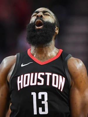 Houston Rockets guard James Harden (13) reacts after a shot on the New Orleans Pelicans during the fourth quarter at Toyota Center.
