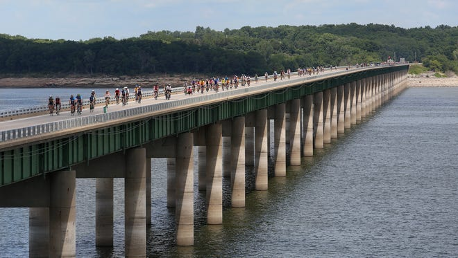Bicyclists cross Lake Red Rock on Highway 14 on their way into Knoxville in this file photo.
