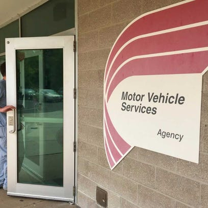 A motorist enters an office of New Jersey's Motor Vehicle