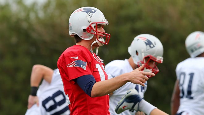 JANUARY 29: Tom Brady #12 of the New England Patriots looks on during warmups before the start of the New England Patriots Super Bowl XLIX Practice on January 29, 2015 at the Arizona Cardinals Practice Facility in Tempe, Arizona.