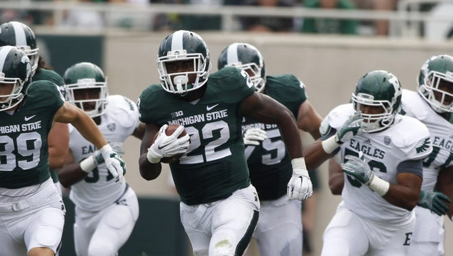 Michigan State's  running back Delton Williams (22) breaks away for an 80-yard touchdown in the fourth quarter of their 73-14 win over Eastern Michigan in East Lansing, Mich.
