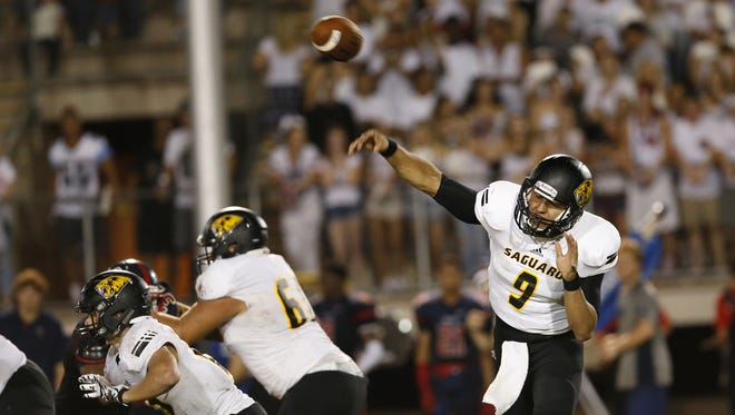 Saguaro quarterback Kare Lyles passes the ball during a high school football game against Centennial at Glendale Community College in Glendale on Thursday, August 27, 2015.