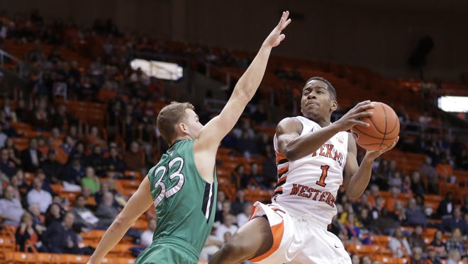UTEP's Dominic Artis prepares for a mid-air collision with Marshall's Jon Elmore in a game earlier this year. UTEP is starting a four-game road trip.