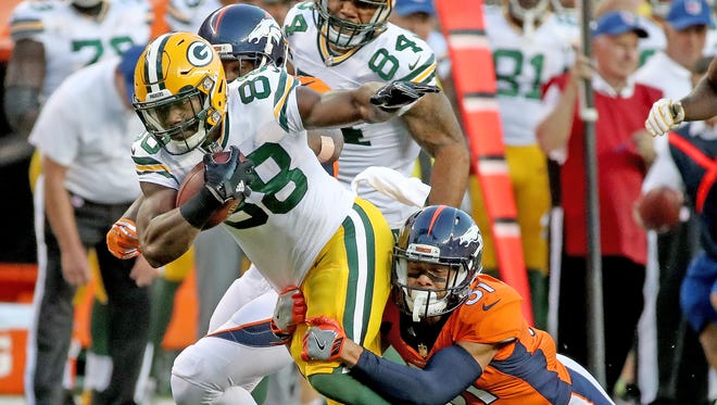 Green Bay Packers running back Ty Montgomery (88) runs the ball during the game against the Denver Broncos Saturday, August 26, 2017 at Sports Authority Field at Mile High.