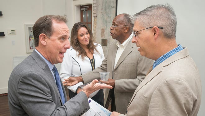 At right, Chuck Marohn, president and founder of Strong Towns, chats after his presentation to civic and business leaders during CivicCon on Tuesday, Sept. 26, 2017, in Pensacola.