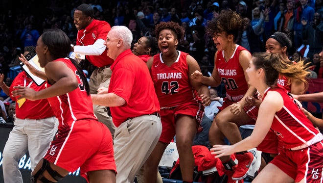 Hazel Green coach Tim Miller and his team celebrate their overtime win over Ramsay in the AHSAA State Championship Game at Legacy Arena in Birmingham, Ala. on Saturday March 3, 2018.
